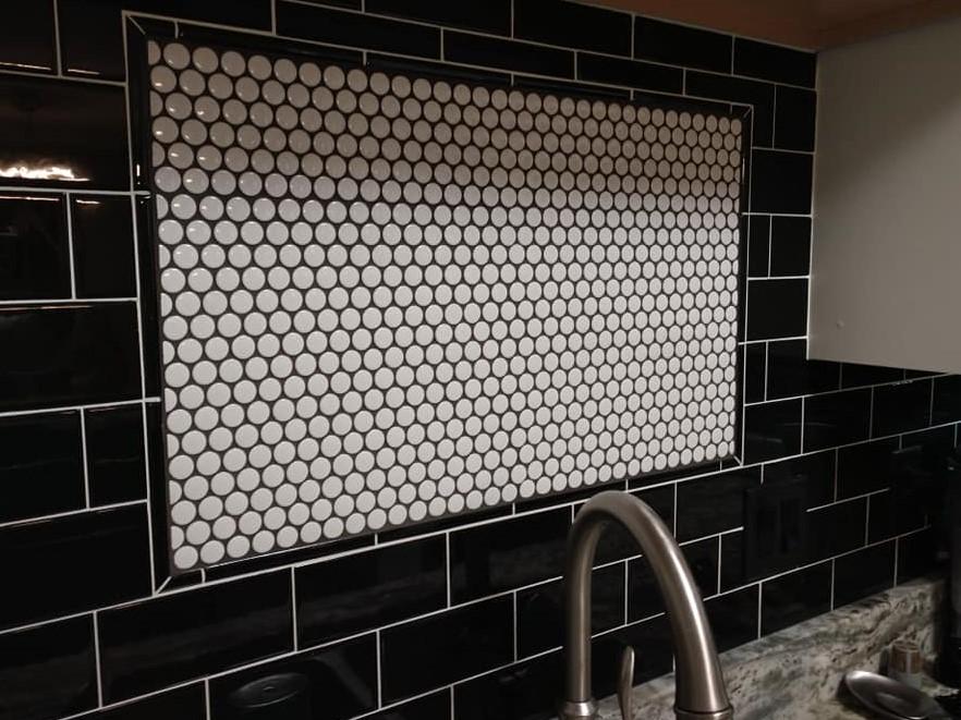 black subway tile, behind the sink, framed accent tile, penny tile, backsplash, black and white, round tile, circle tile, mosaic tile, accent tile