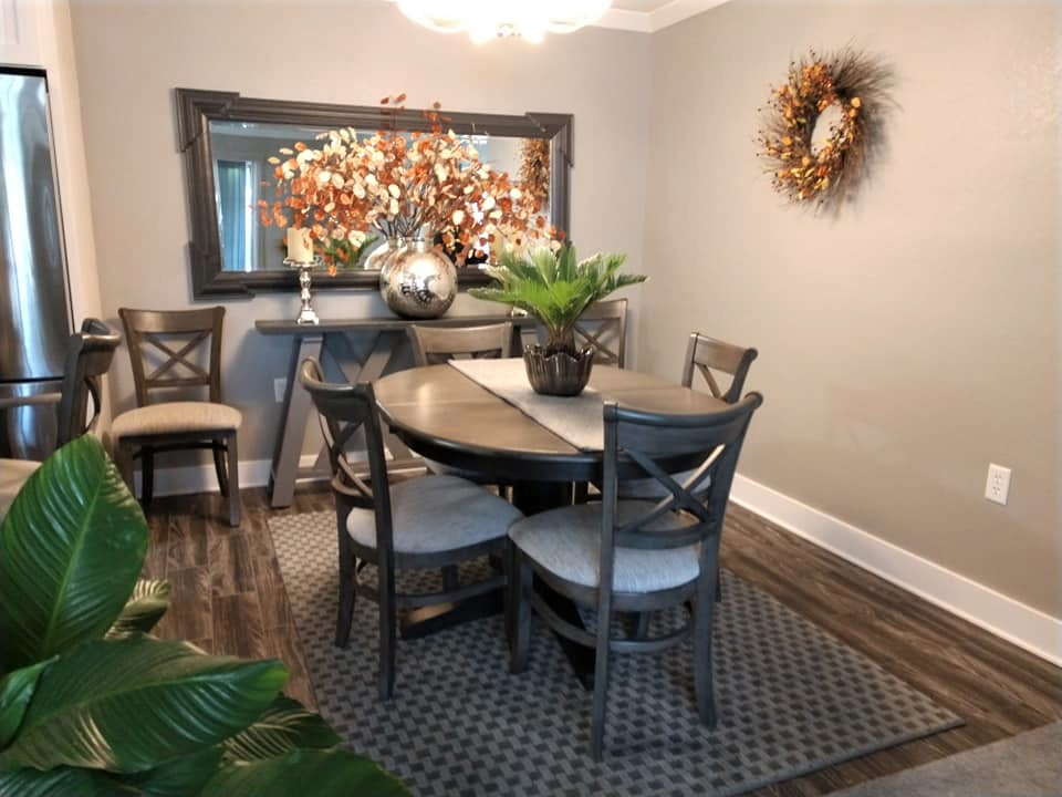 wood plank, ceramic tile, dining room, brown, taupe, carpet tile transition, checkerboard rug
